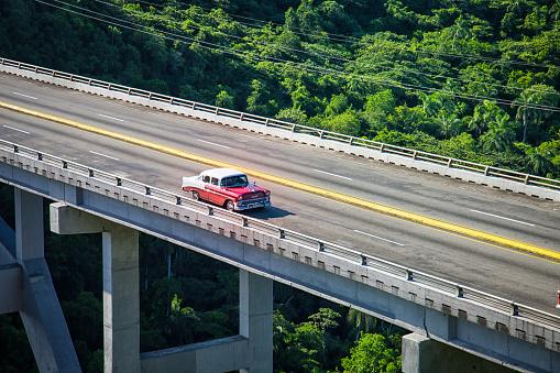 Old Car crossing the bridge - gettyimageskorea