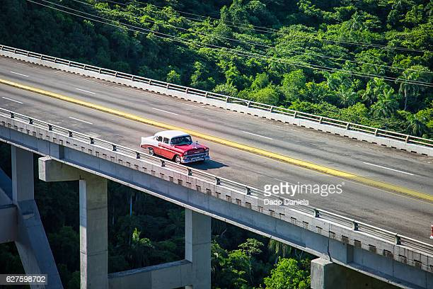 old car crossing the bridge - varadero beach stock pictures, royalty-free photos & images