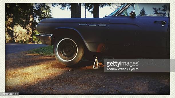 old car elevated on jack - andrew jack stock pictures, royalty-free photos & images