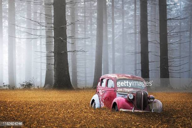 old car in field - beaten up stock pictures, royalty-free photos & images