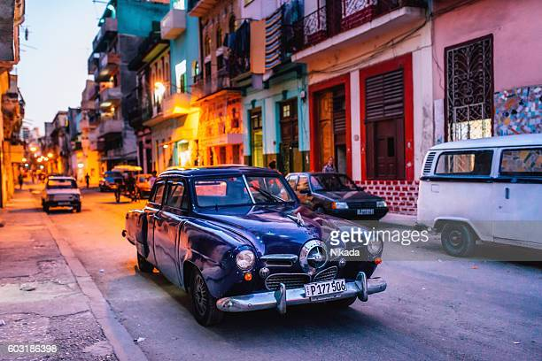 Old  car on street at dusk, Havana, Cuba