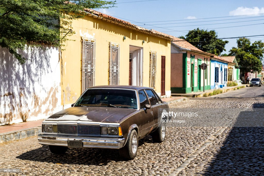 Old car on the street in historic center. One of the oldest ...