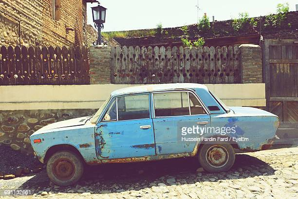 old car parked in street - beaten up stock pictures, royalty-free photos & images