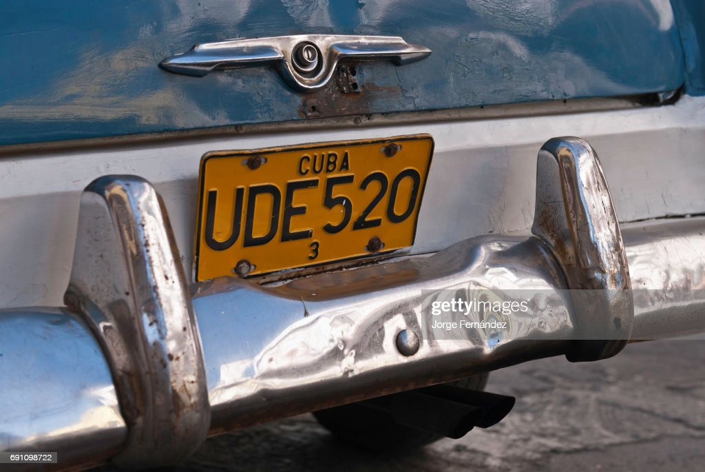 Old car plate on the streets of Santiago de Cuba... Pictures | Getty ...