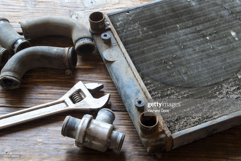 Old car radiator on a wooden table. : Stock Photo