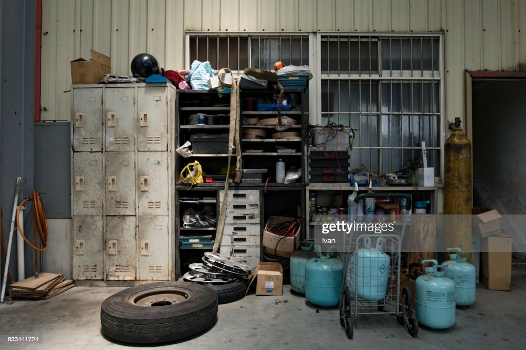 Old Car Repair Shop Interior With Mechanic In Background Stock Photo ...