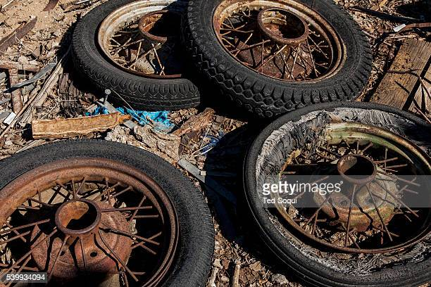 Old car wheels at Bottle Tree Farm US Route 66 also known as the Mother Road in the Mojave desert of California The two major connector cites in the...