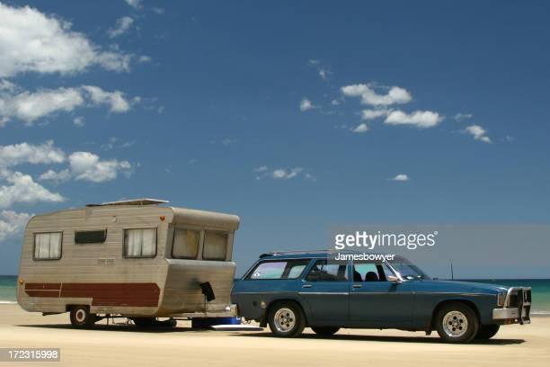 Old Caravan & car on beach