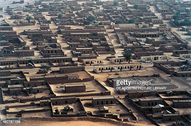 Old caravan city buried by sand Sahel desert Mauritania