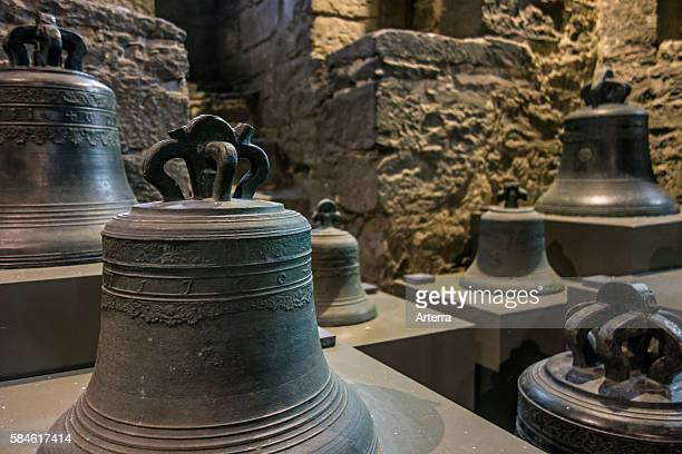 Old carillon bells on display in museum in the belfry at Ghent Belgium
