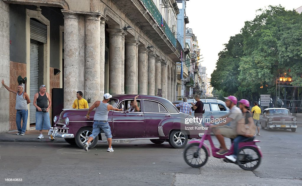 Old Cars And People On Line Stock Photo | Getty Images