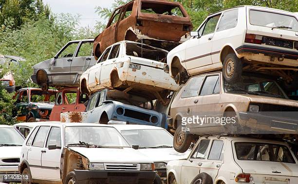 old cars graveyard - junkyard stock photos and pictures