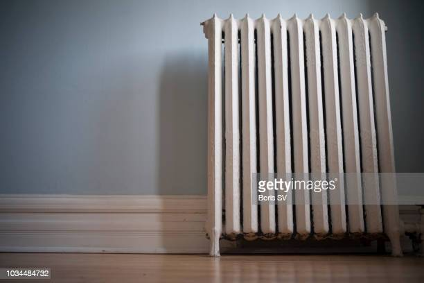 old cast iron radiator, surface level - radiator heater stock photos and pictures