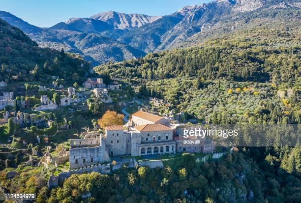 old castle ruins on a mountain - peloponnese stock photos and pictures