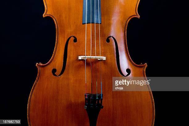 Old cello on dark background