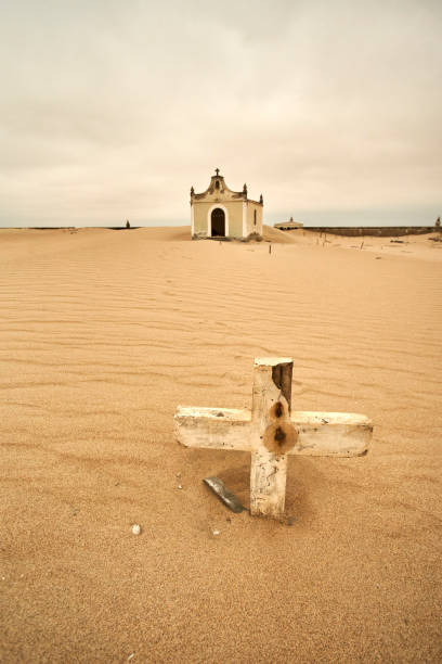 Old cemetery at the abandoned village of Ilha dos Tigres, Angola