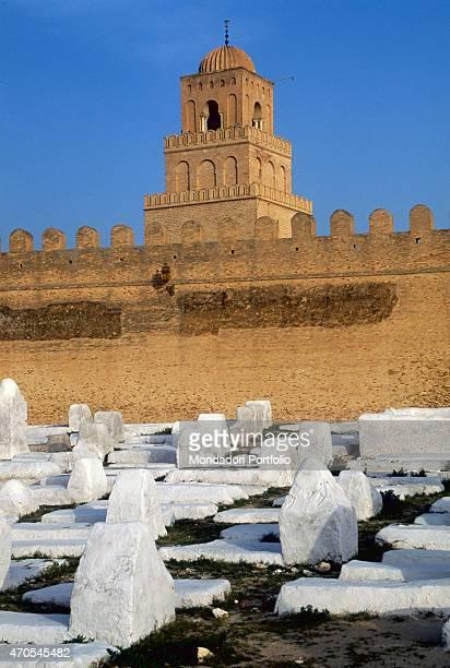 'Old cemetery near the minaret of Kairouan by Aghlabid craftmen 9th Century brickwork Tunisia Kairouan Whole artwork view White tombstones in the...