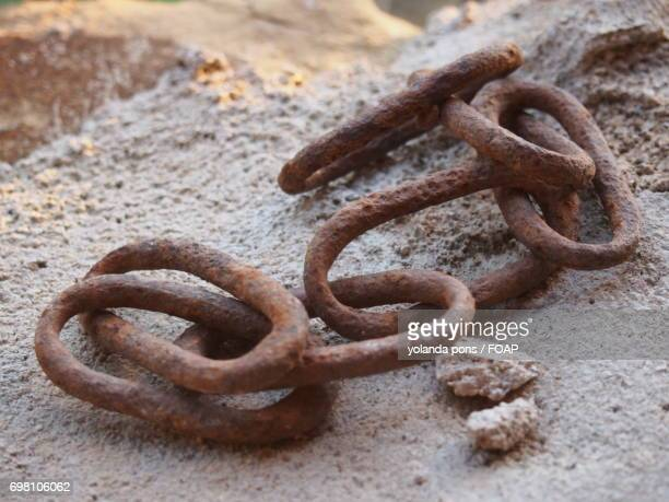 Old chain links on rock