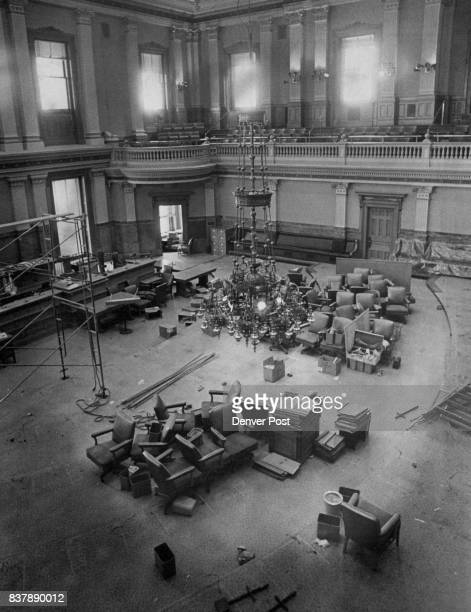 Old chairs wait in desolate clusters for new carpets and desks in the newly painted House during the refurbishing of the legislative chambers Credit...