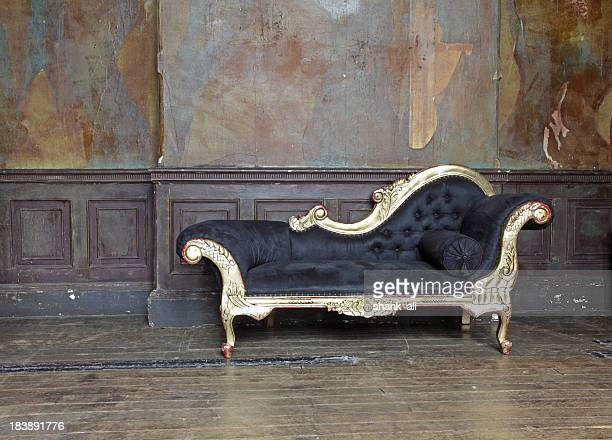 Old chaise lounge in old room