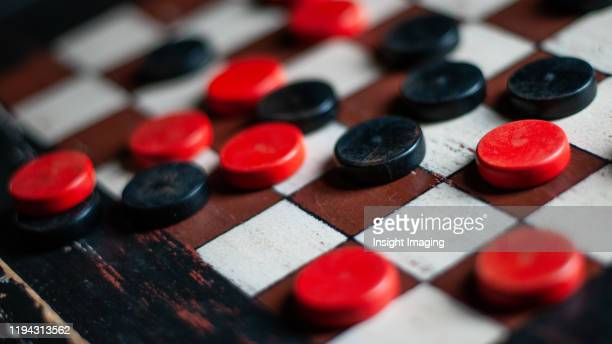 old checker board - chequers stock pictures, royalty-free photos & images