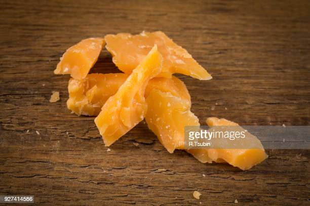 old cheese close up - cheddar cheese stock photos and pictures