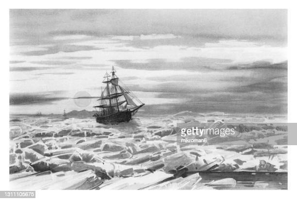 old chromolithograph illustration of midnight sun. sailing ship in the floating ice - lithograph stock pictures, royalty-free photos & images