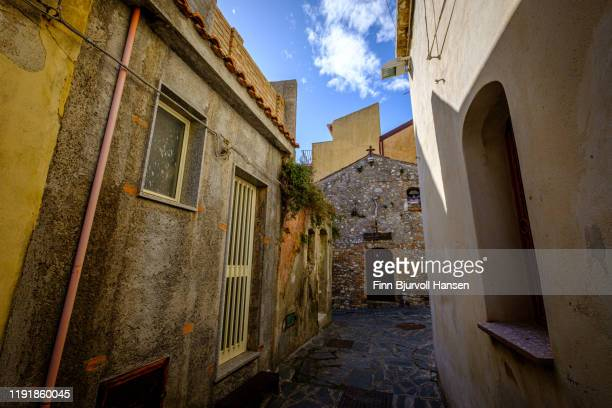 old church in a narrow alley in castelmola, taormina, sicily, italy - finn bjurvoll stock photos and pictures