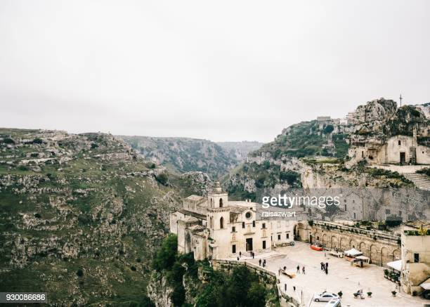 old church in mountains, matera, italy - matera italy stock pictures, royalty-free photos & images