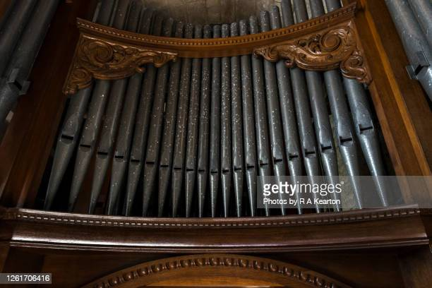 old church pipe organ in an english church - church organ stock pictures, royalty-free photos & images