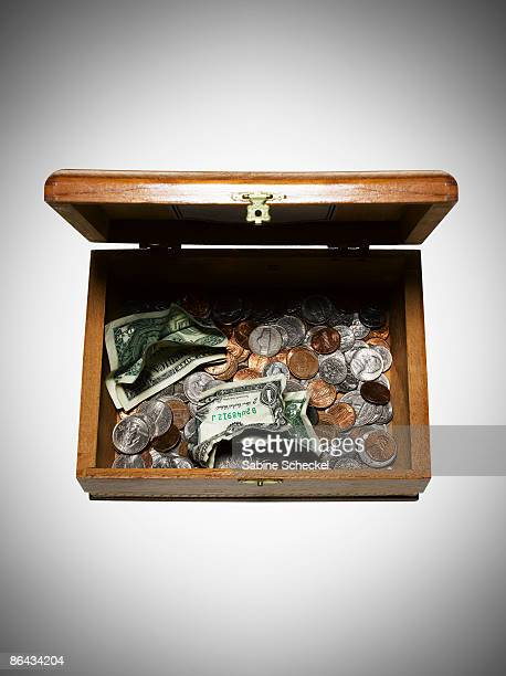 old cigar box filled with change