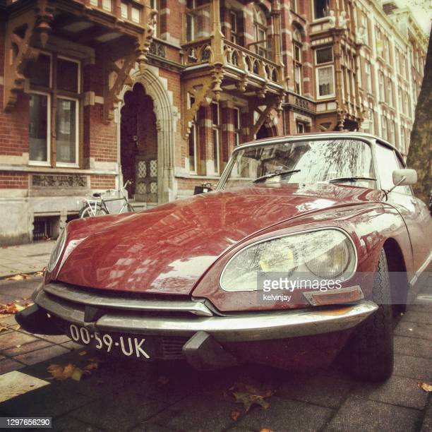 old citroen ds car on the streets of amsterdam - brand name stock pictures, royalty-free photos & images