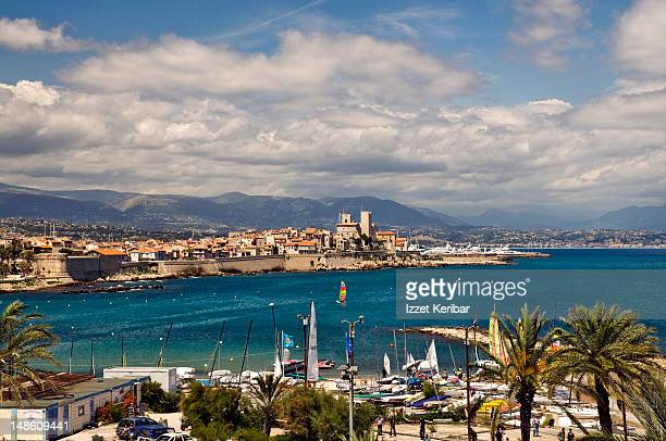 old city and port of antibes looking towards fort carre. - antibes stock photos and pictures