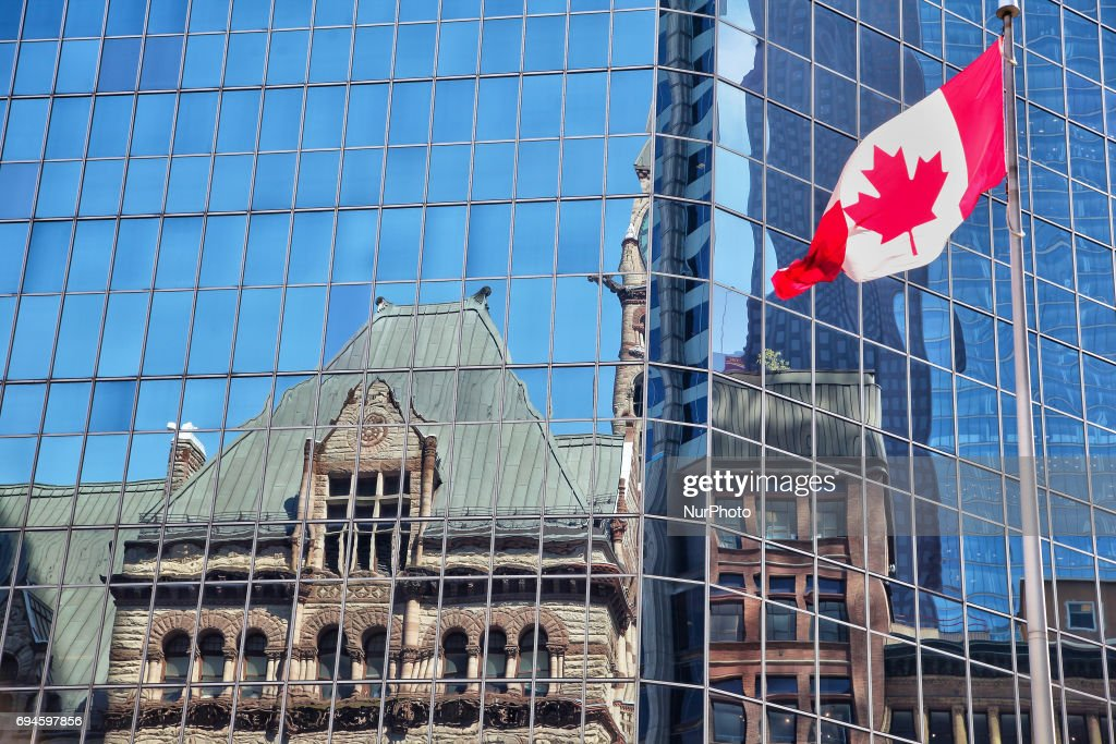 Old City Hall building reflected in an office building in downtown Toronto, Ontario, Canada, on June 10, 2017.