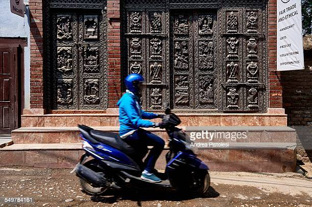 old city of patan, nepal - mobylette photos et images de collection
