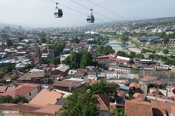 old city with peace bridge. tblisi. georgia. - tbilisi stock pictures, royalty-free photos & images
