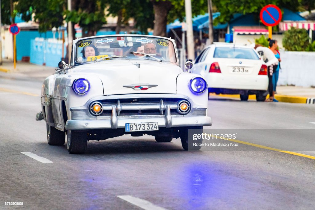 Old classic cars driving or in action. Cuba is known for the ...