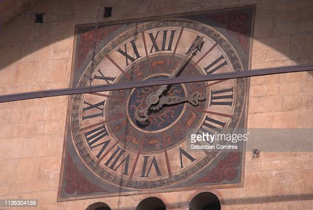Old Clock, hour 3 and three minutes, Detail of the cathedral in Verona, Italy