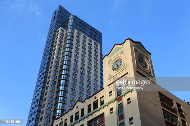 old clock tower with modern highrise condominium tower in the background in brooklyn, new york city - clock tower stock pictures, royalty-free photos & images