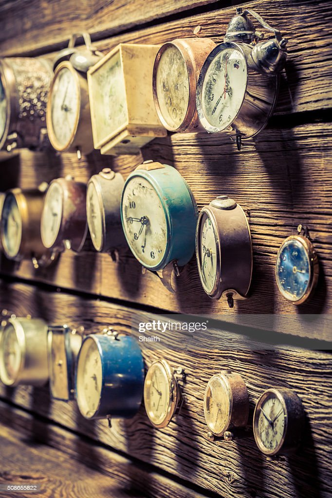 Old clocks on the wooden wall : Stock Photo