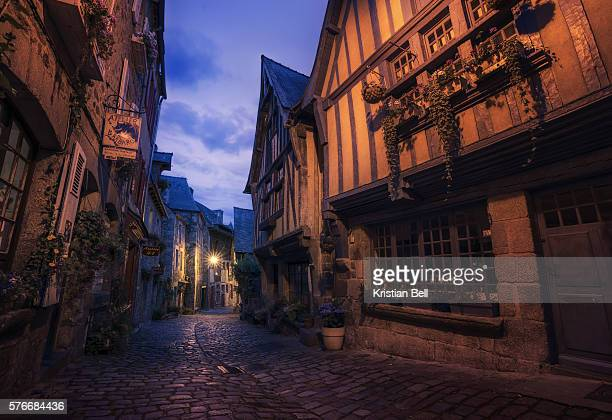 old cobbled street in the town of dinan, brittany, france - brittany bell stock photos and pictures