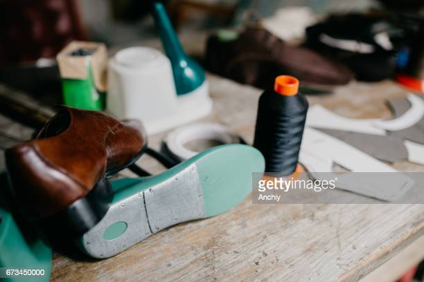 Old cobbler workshop with tools and spare parts