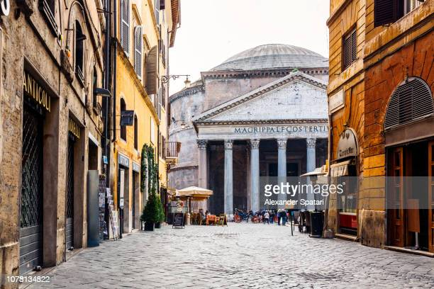 old cobblestone street in rome and pantheon in the center, italy - rome italy stock pictures, royalty-free photos & images