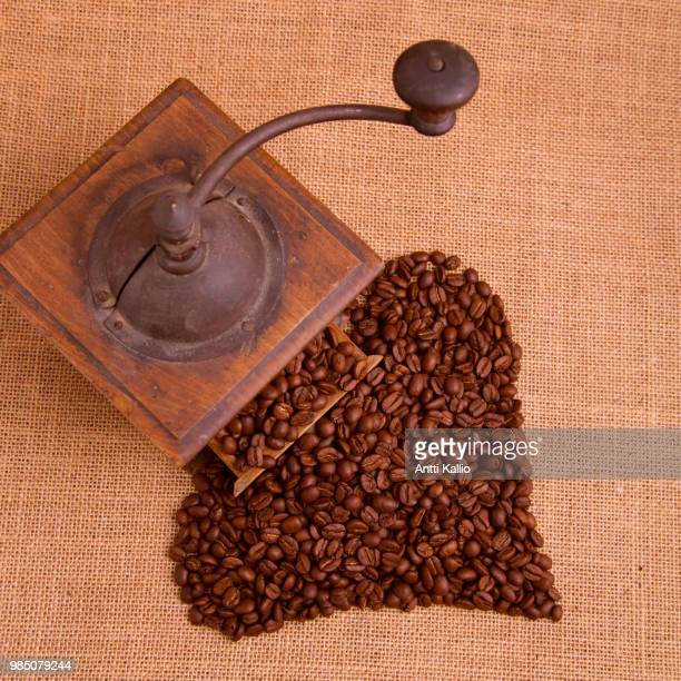 old coffee grinder and coffee beans - coffee grinder stock photos and pictures