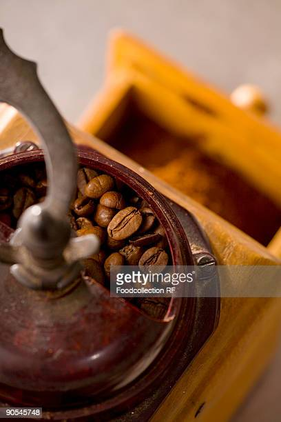 Old coffee mill with coffee beans, overhead view
