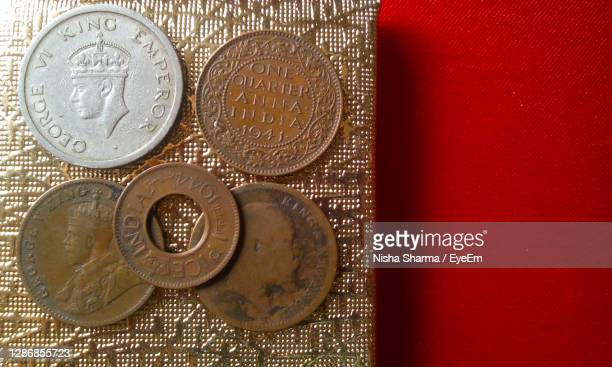 old coins of india approx. 70 to 90 years old - 1947 stock pictures, royalty-free photos & images