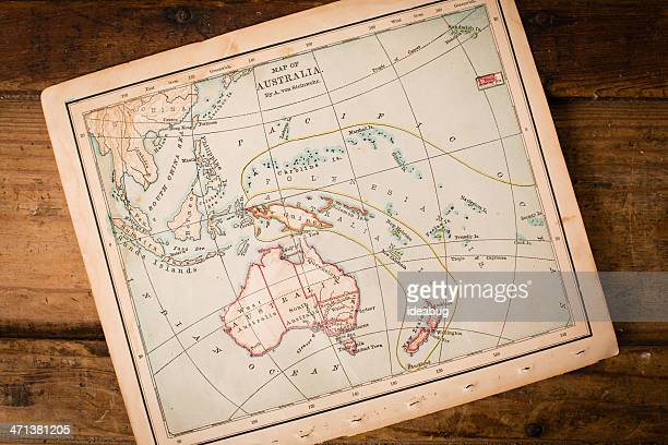 Old, Color Map of Australia, Sitting on Wood Trunk