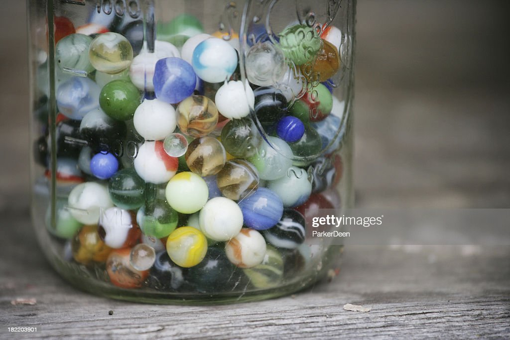 Old Colorful Marbles in a Glass Jar : Stock Photo