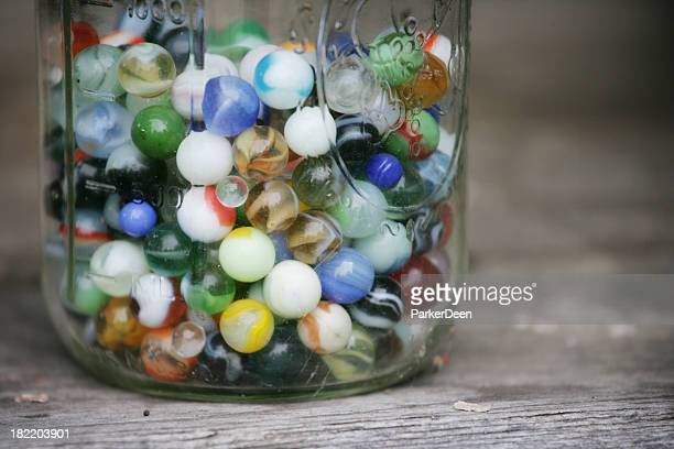 Old Colorful Marbles in a Glass Jar