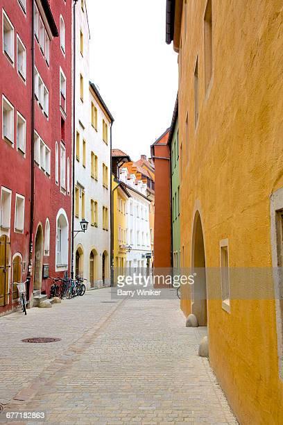 old colorful street, regensburg, germany - レーゲンスブルク ストックフォトと画像